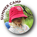 Young girl wearing Summer Camp hat